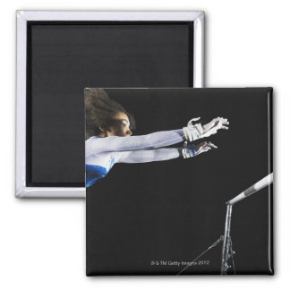 Gymnast (9-10) reaching for uneven bars 2 fridge magnet