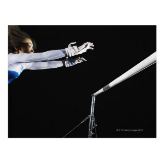 Gymnast (9-10) reaching for uneven bars 2 post card