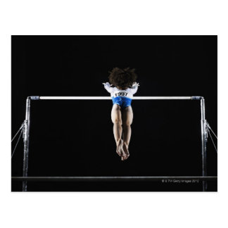 Gymnast (9-10) reaching for uneven bars post card