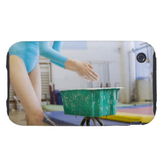 Gymnast chalking her hands iPhone 3 tough case