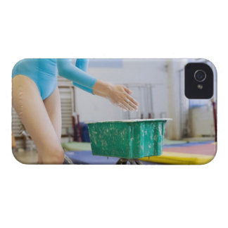Gymnast chalking her hands iPhone 4 cover