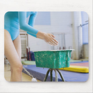 Gymnast chalking her hands mouse pad