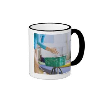 Gymnast chalking her hands ringer mug