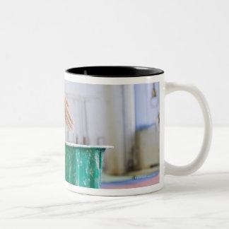 Gymnast chalking her hands Two-Tone coffee mug