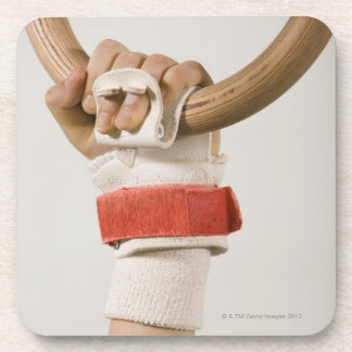 Gymnast hand holding ring drink coaster