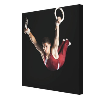 Gymnast swinging from rings stretched canvas print