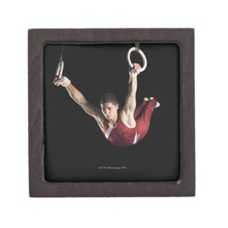 Gymnast swinging from rings gift box