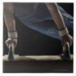 Gymnast swinging on pommel horse ceramic tile