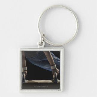 Gymnast swinging on pommel horse keychain
