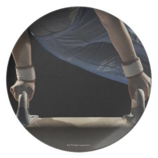 Gymnast swinging on pommel horse melamine plate
