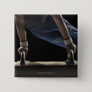 Gymnast swinging on pommel horse pinback button