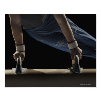 Gymnast swinging on pommel horse poster