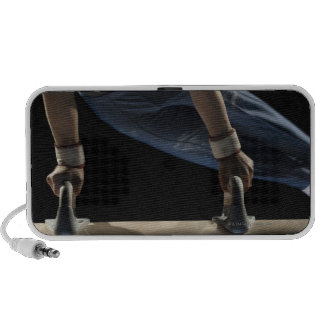 Gymnast swinging on pommel horse mini speaker