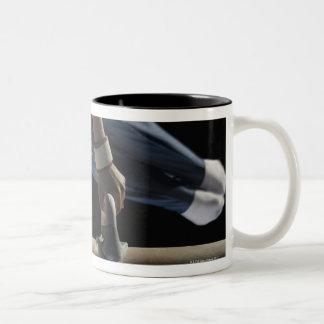 Gymnast swinging on pommel horse Two-Tone coffee mug