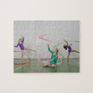 Gymnastics girls dancing with ribbons jigsaw puzzle