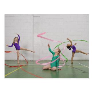Gymnastics girls dancing with ribbons postcard