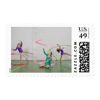 Gymnastics girls dancing with ribbons stamp