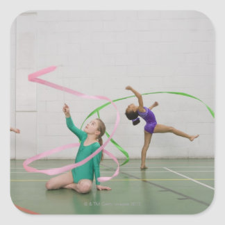 Gymnastics girls dancing with ribbons square sticker