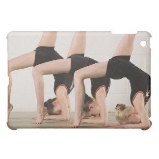 Gymnasts posing upside down iPad mini covers