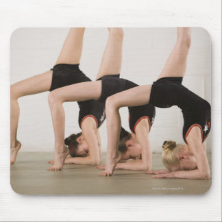 Gymnasts posing upside down mouse pad