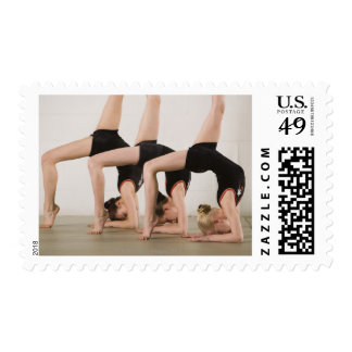 Gymnasts posing upside down postage