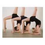 Gymnasts posing upside down postcard