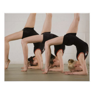 Gymnasts posing upside down poster