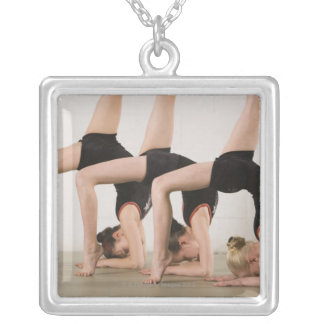 Gymnasts posing upside down square pendant necklace