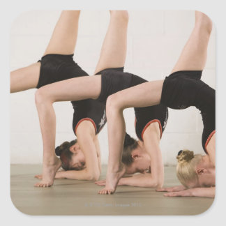 Gymnasts posing upside down square sticker