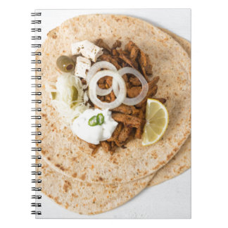 Gyros pita with tzatziki coleslaw olives and feta spiral notebook