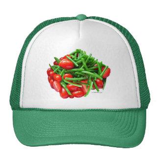 Haba verde y tomates gorros