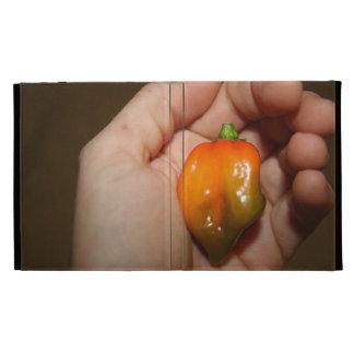 Habanero hot pepper in female hand iPad folio cover