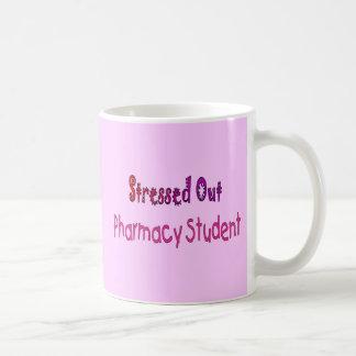 Hacia fuera subrayado estudiante de la farmacia taza