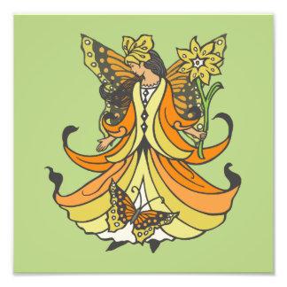 Hada anaranjada de la mariposa con el vestido que fotografías