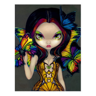 Hada con la postal de una máscara de la mariposa