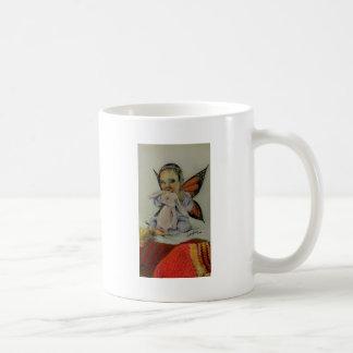 Hada del bebé con el conejito taza de café