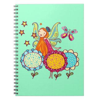 Hada del jardín con las flores cuaderno
