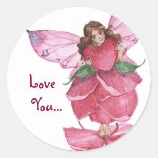 Hada del pétalo color de rosa que lleva a cabo el pegatina redonda