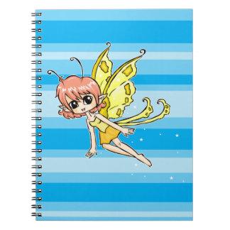 Hada linda del dibujo animado con las alas amarill libro de apuntes con espiral