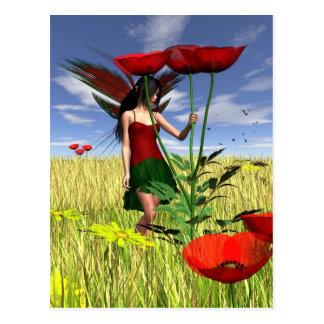 Hada roja de la amapola en un campo del verano postales