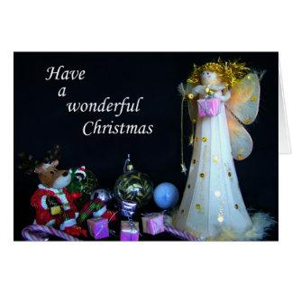 Hada y reno, tarjeta de las felices Navidad,