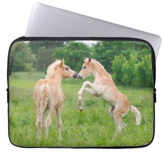 Haflinger horses cute foals rearing computer sleeve