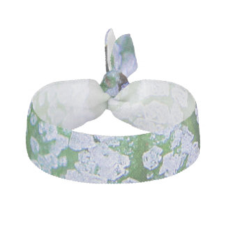Hair tie ice cubes and green background