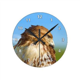 halcón Áspero-legged en reloj del perfil