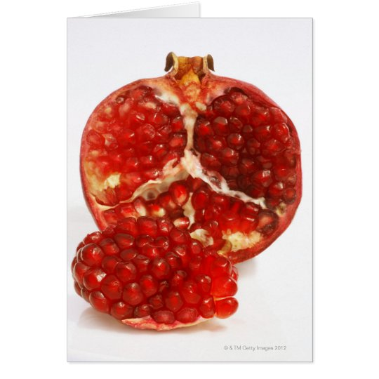 Half a ripe pomegranate cut to expose the juicy card