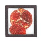 Half a ripe pomegranate cut to expose the juicy keepsake box