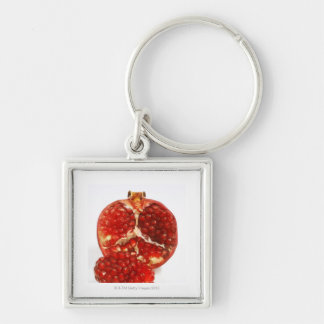 Half a ripe pomegranate cut to expose the juicy keychain