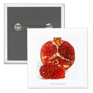 Half a ripe pomegranate cut to expose the juicy pinback button