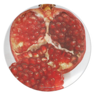 Half a ripe pomegranate cut to expose the juicy plates