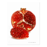 Half a ripe pomegranate cut to expose the juicy postcards